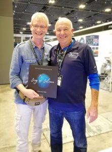 Emmy Award winner Marty Snyderman and Rico Besserdich at the ADEX Show 2018, Singapore. The copy was a gift for his mom.